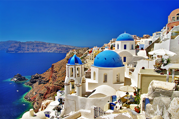Image result for greek city blue roofs