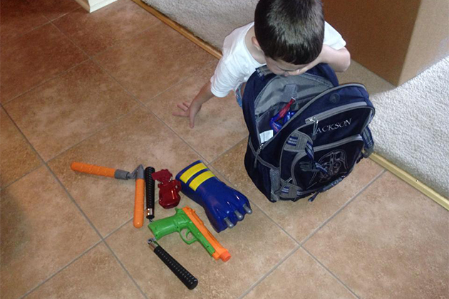 kids carryon full of plastic weapons