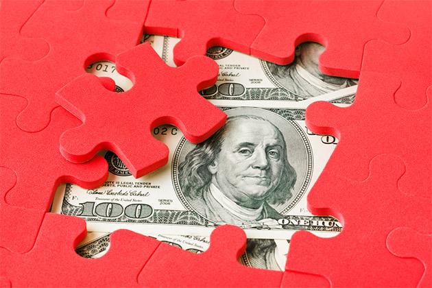 Hidden money under a puzzle