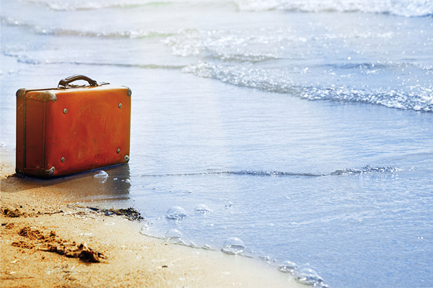 lone suitcase lost on the beach