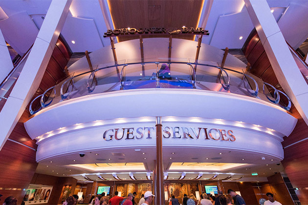 Shot of Oasis' Guest Services desk & Schooner Bar