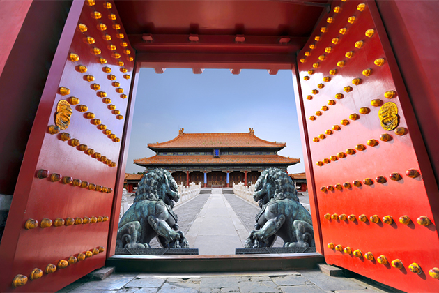 Red entrance gate opening to the forbidden city in Beijing