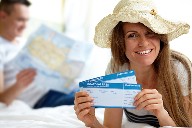 Woman holding her boarding passes
