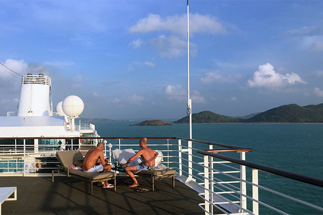 Two men on the top deck of Azamara Quest