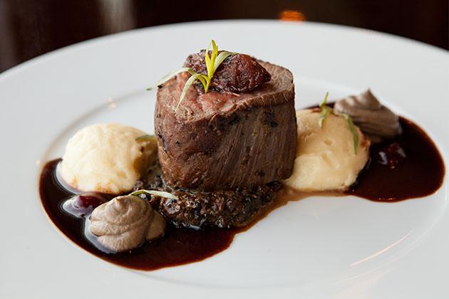 Steak entree at specialty restaurant