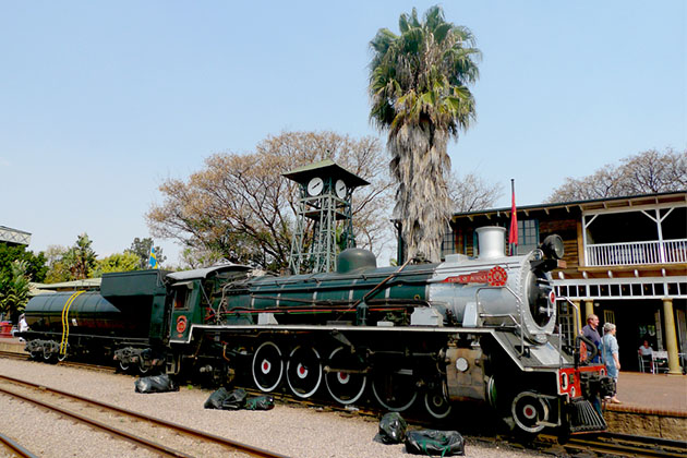 Steam train about to depart from Capital Park Station in Pretoria