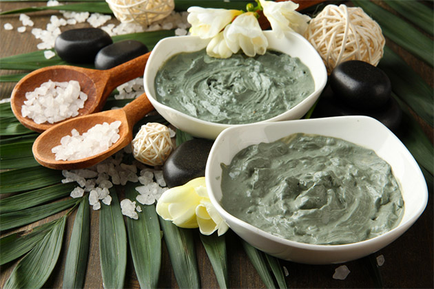 Two bowls of green spa treatment mixture