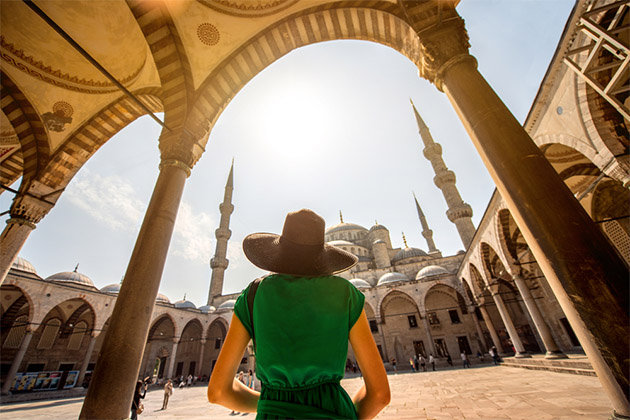 woman looking on Blue Mosque in Istanbul, Turkey