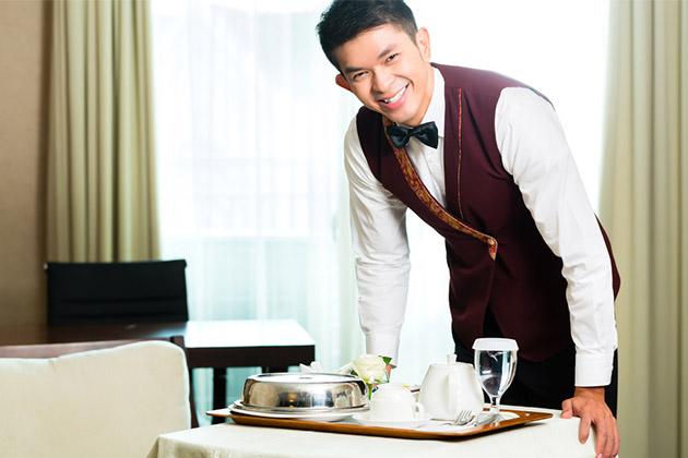 Cabin steward bringing room service