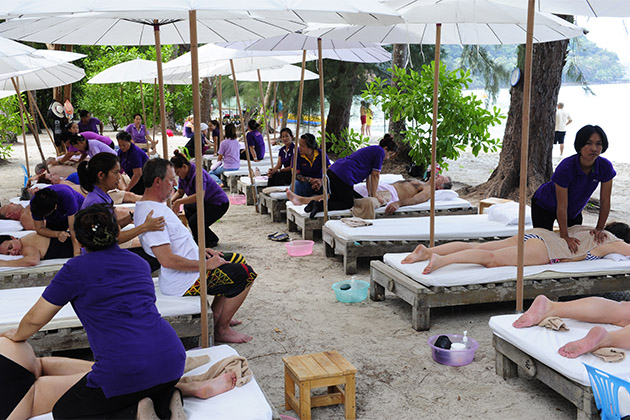 Seabourn passengers getting thai-style massages on the beach