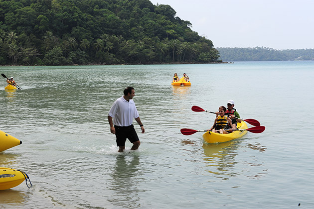 Seabourn passengers kayaking by the shore
