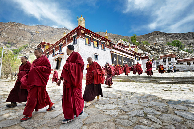 monks leave the main assembly hall of Sera monastery