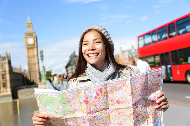 Woman Sightseeing Holding Map