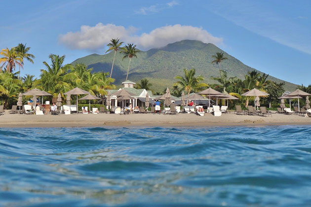 Pinney's Beach at the foot of the Nevis Peak volcano