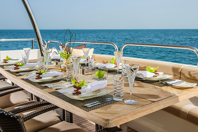 Dinning table on the upper deck in luxurious yacht