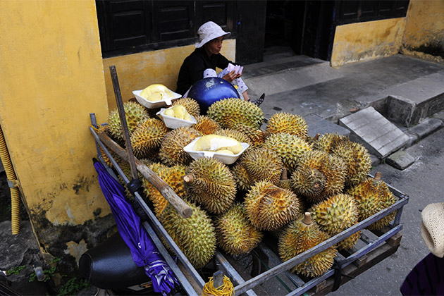 Local with a wagon full of durian fruit
