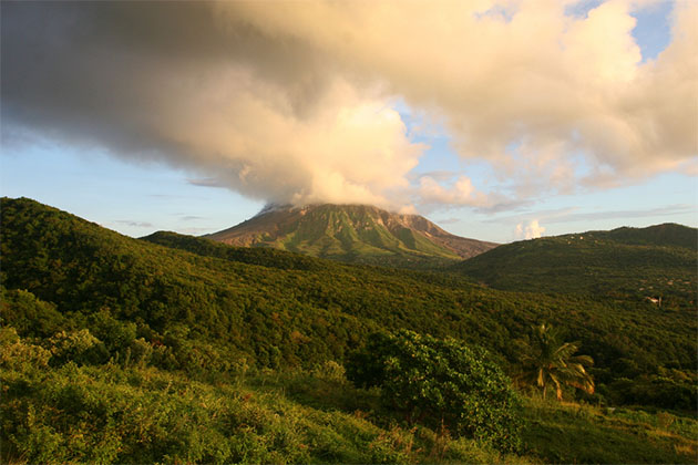 Mount Soufriere smoking volcano at sunset
