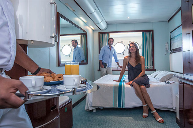 Couple Enjoying Service in Club Med 2 Cabin