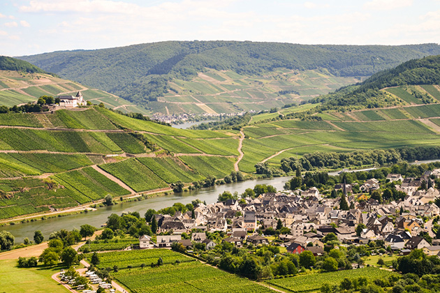 View to river Moselle and Marienburg Castle near village Puenderich