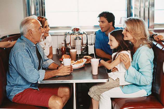 Multi-generational family dining at Johnny Rockets on Freedom of the Seas