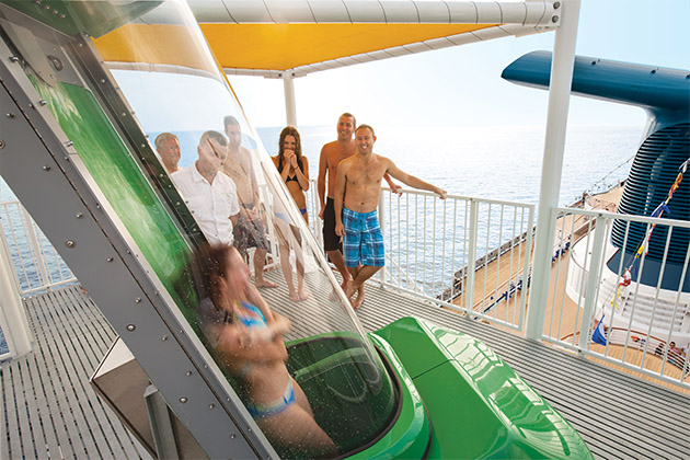 Woman going down the Green Thunder waterslide on Carnival Spirit