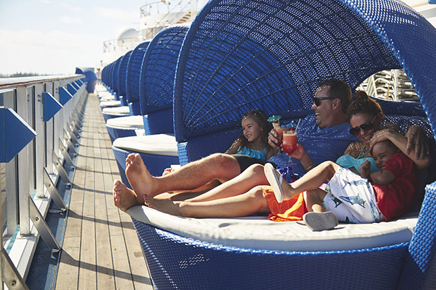 Family lounging in an upper pod on a Carnival cruise deck