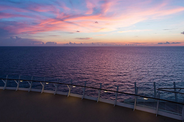View of the sunset from a cruise ship deck