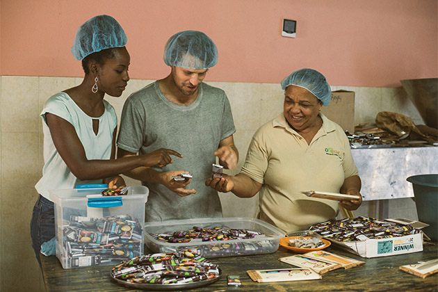 Fathom passengers and local woman working in the chocolate factory