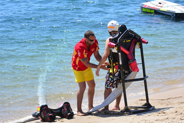 An instructor prepares a client for flyboarding