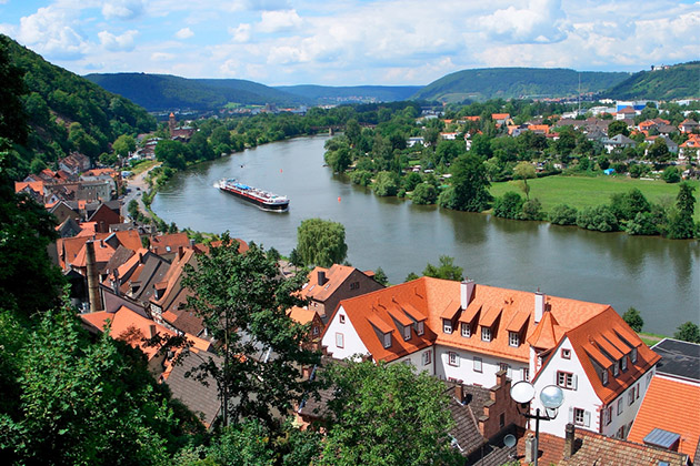Riverboat cruising down the Main River in Miltenberg, Germany