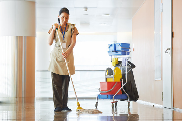 Adult cleaner maid woman with mop and uniform cleaning