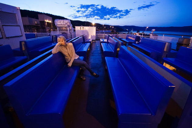 Woman alone on a ship deck