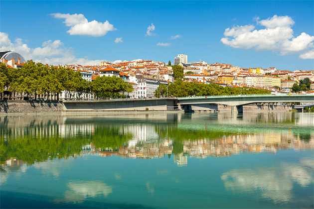 Cityscape of Lyon, France with reflections in the water. Bright sunny day