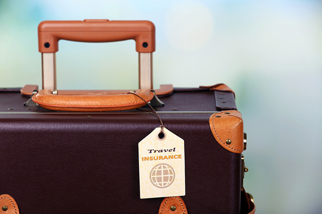 Suitcase with travel insurance label