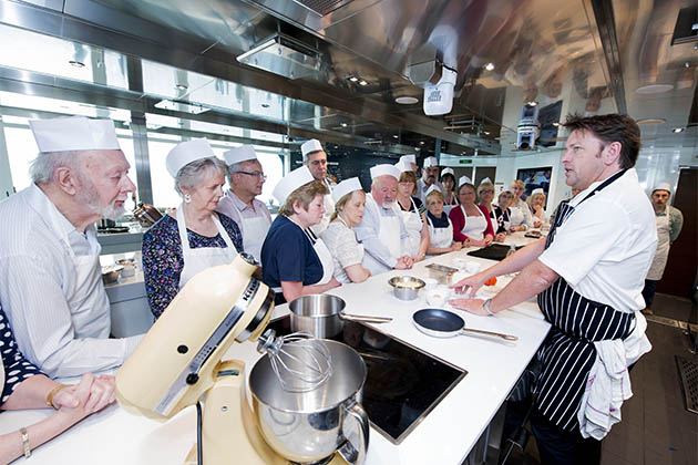 James Martin teaching a cooking class to cruise passengers on Britannia