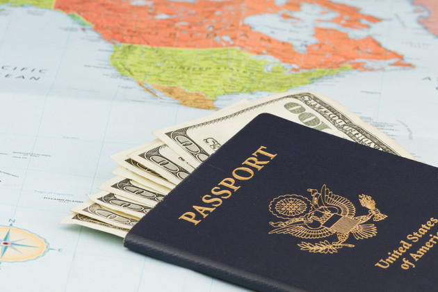 American passport with American currency and a map as a background