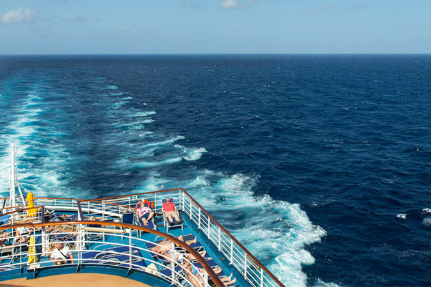 People sunbathing on the aft sundeck on Carnival Dream