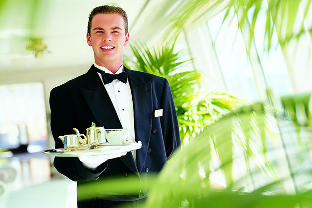 Waiter serving afternoon tea