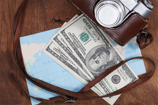 map, old camera and money