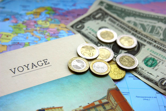 Cruise pamphlet with map and assorted currencies