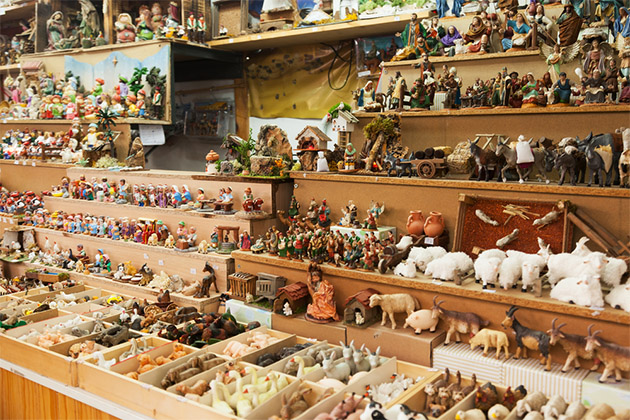 Counter of kiosk with figures for creating miniature Christmas scenes at a Barcelona Christmas market