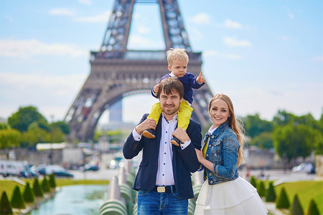 Family of three in front of the Eiffel Tower in Paris