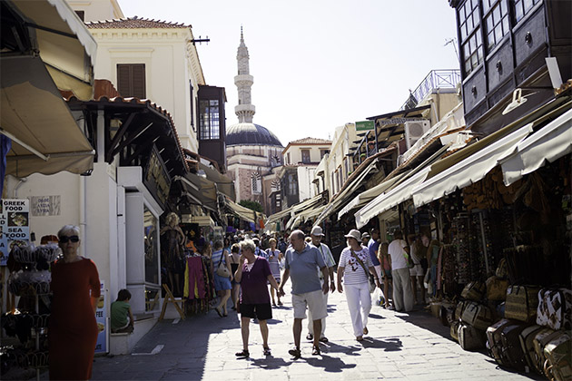 Azamara passengers walking through the Old Town of Rhodes in Greece