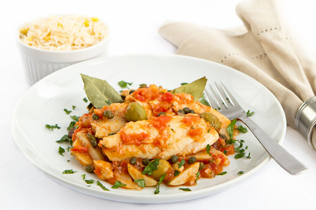 The Tides' Steamed Bajan Flying Fish Seasoned and Braised in a Rich Tomato Creole Sauce