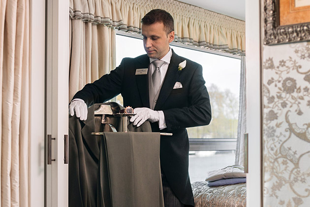 Uniworld butler hanging a man's suit