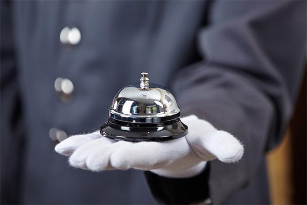 Butler holding a bell