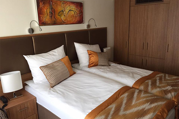 Orange and brown cabin decor on Vantage's River Voyager