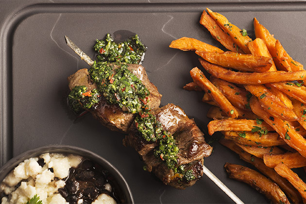 Steak kebabs and sweet potato fries from Crystal Serenity's evening menu