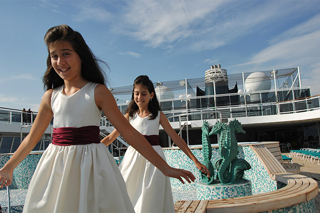 Two girls in pretty dressed on a Crystal Cruises sun deck