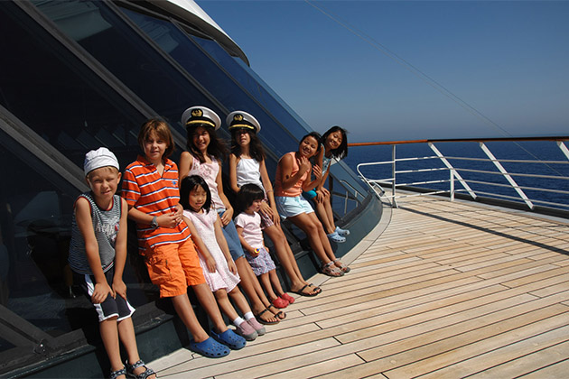 Group of kids lined up on a Crystal Cruises ship